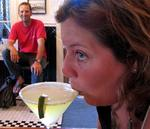 Greg watches as Anne sips her Key Lime Pie Margarita (the glass is dusted with graham cracker crumbs instead of salt.)