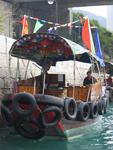 The sampans are charming little boats that resemble tiny tug boats--they have more tires than a truck!