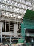 Modern buildings are repaired with bamboo scaffolding.