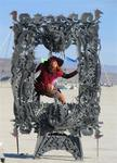 Cherie in a frame in the middle of Black Rock Desert at the Burning Man Festival 2005. *Photo by Greg.