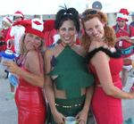 Lisa, Cherie and Karem dressed in holiday cheer.