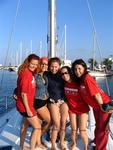 The ladies prepare to rock the boat as they sail from Ibiza to Formentera.