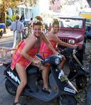 The two Wilmas on mopeds.