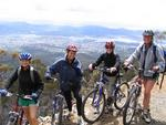 Hannah, Cherie and Elizabeth bike down Mt. Wellington.