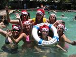 Celebrating Christmas 2005 at the Whitsundays.  In the pool at Club Croc in Long Island, we splash around in our Santa hats.