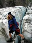 Cherie steps over a crack.  Glaciers, like English muffins, have lots of nooks and crannies.