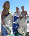 Spinnaker chicks: Anne, Cherie and Karen. *Photo by Rennie.