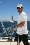 Greg on the main sheet. *Photo by Karen Vaccaro S/V Miela.