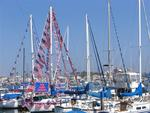 Patriotic yachts gather for the Newport Beach Old Glory Boat Parade on July 4th.
