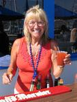 The American Legion office manager Linda Christensen doubles as the 4th of July bartender.