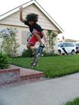 Tyler flying on his skateboard at 11-years old.