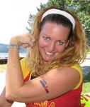 Cherie wears an Ironman tattoo to support her friends (Kevin, Justin & Chris) competing in the Coeur d'Alene Ironman in Idaho.