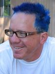Justin dyes his hair bright blue so he's easy to spot during the race.