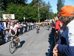 Crowds gather along the bike route and root for the racers.