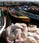 Boats at the market in Inle Lake. *Photo by Jean Leitner.