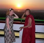 Cherie talking to a monk at sunset on Mandalay Hill. *Photo by Jean Leitner.