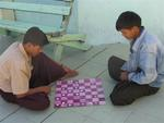 Myanmar men playing checkers.