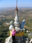 Jean surrounded by the dramatic temple tops of Taung Kalat.