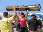 Marilyn Mickey is lifting a 110-pound log over her head, and doing multiple reps.