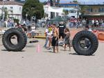 In the tire flip, massive tires weighing 650-pounds are flipped 5 times (end over end) down the beach.