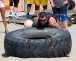 Strategy: Get a hold of the tire, dig into the sand, and flip.