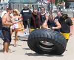 What do you want to do this weekend?  Watch big guys flip tires across the beach?