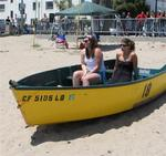 Girls chillin' in a beached boat.