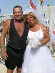 After over a decade of dating, Rennie and Anne tied the knot.  We re-created the ceremony at Burning Man with silk boxers for the groom and a thrift-store bought wedding dress for the bride.