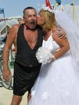 A wedding kiss seals the deal in the Black Rock Desert.