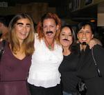 "Four ladies eagerly darn mustaches, bushy eyebrows and goatees at the Mushtache Party held at the Costa Mesa restaurant called ""Memphis."""