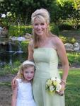 Kate, the flower girl with her mom Debbie. *Photo by Cherie Sogsti.