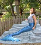 Kristi can swim so much faster now that she's a mermaid!