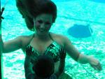 Mermaid Marci's daugher recognizes her even under water. Photo by John Athanason.
