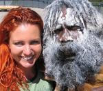 "Cherie with an Australian Aborigine.  Body painting is an important Aboriginal ceremonial custom; the white ochre ""paint"" is derived from kaolin."