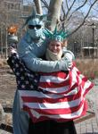 "Cherie gets a giant ""Liberty-sized"" hug from one of mime-statues in Battery Park."