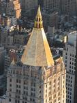 Golden NY rooftops gleam in the sun.