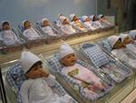 "These life-like babies are waiting at the FAO Schwartz ""Nursery Adoption Center."""