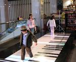 Future musicians entertain themselves (and their parents) on this king-sized keyboard.