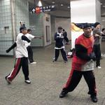 The New York City Float Committee entertains travelers in the subway terminal.