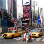 Cyclists and cars share the streets of New York.