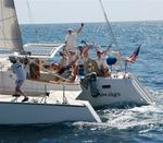 The crew of Seawings gives a hearty wave. *Photo by Richard/Latitude 38.