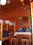 The cabin decorated with 36 balloons.