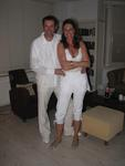 Erik and Claudia dressed in white.
