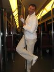 Erik does a pole dance on the subway.