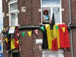 People hanging out of their windows to watch the Tour de France 2007.