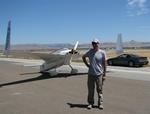 Greg next to his plane and his car. (The plane gets better gas mileage!)