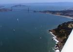 Why is the Golden Gate Bridge brick colored?