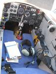 The cockpit of the Long-EZ.  Pilots say the aircraft is manuvered by a side-stick controller; I call it a joystick.