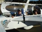 """Rocky"", the flying squirrel, presents pilot Greg and passenger Cherie."