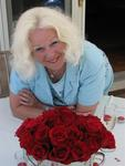 Mom with her vibrant red roses.